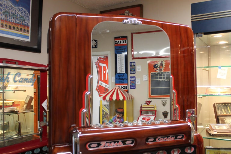 Amazing restoration condition. Completely restored and in working condition. Main attribute of this beautiful machine versus a regular candy machine is it lights up the darkest room, like a movie theater! Best way to find the candy in a 1950s movie