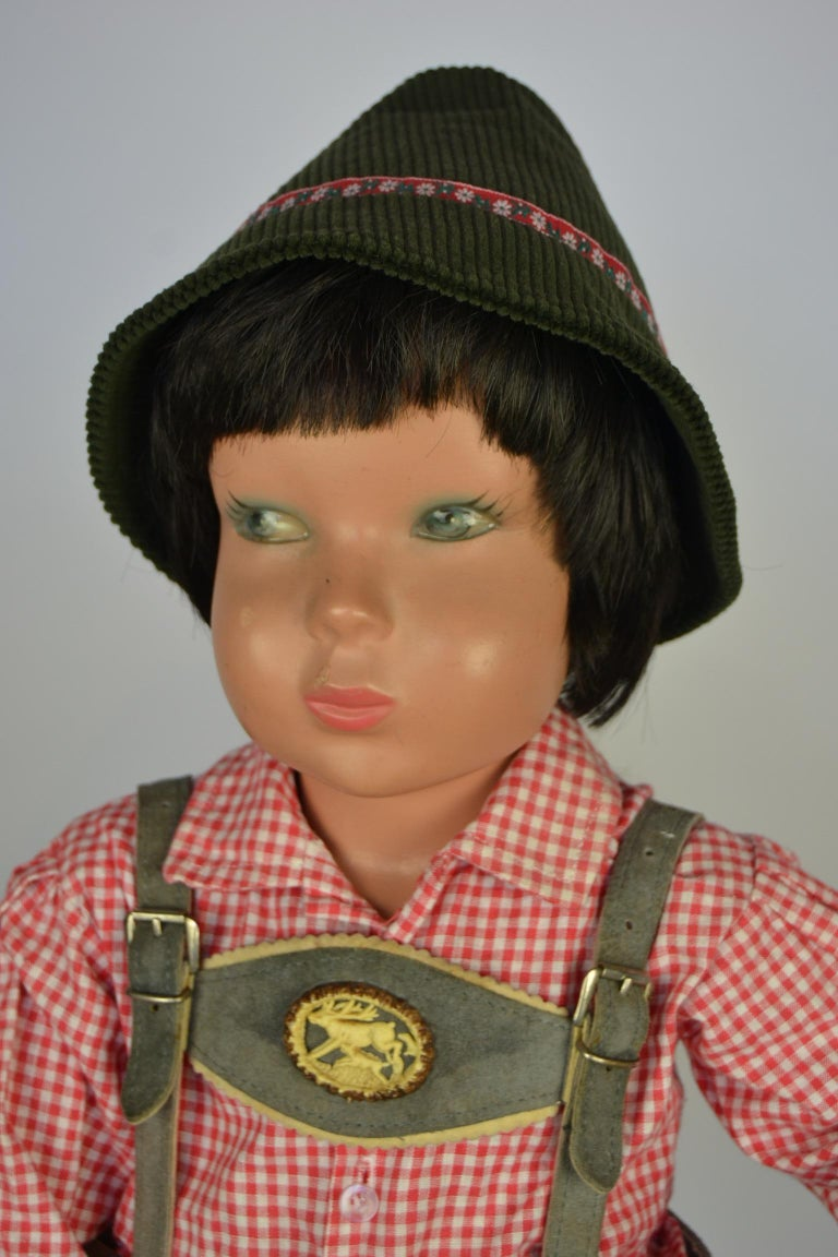 Cute little 1950s mannequin child, shop display child, store window doll. Made in the style of Kathe Kruse, a well known German Doll Company. The boy has low hanging cheeks and fine painted eyes, what gives him a cute, naughty expression. He has
