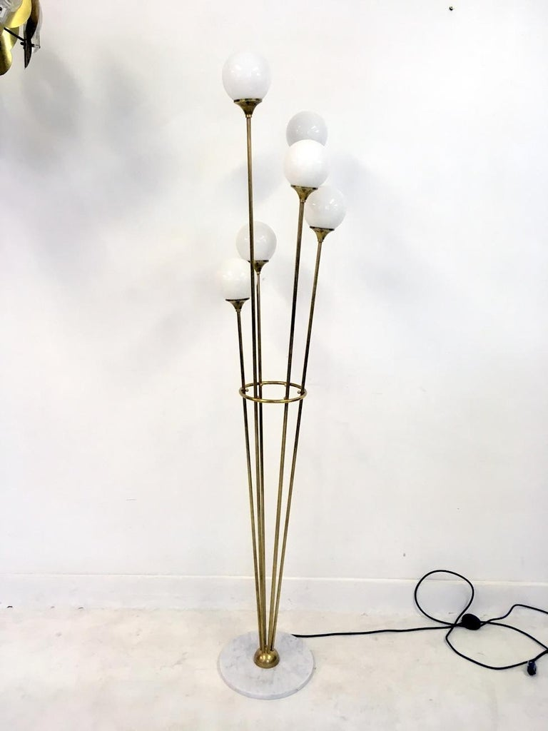 Glass ball floor lamp Brass stems and fittings Marble base 1950s Stilnovo style Made in Italy.