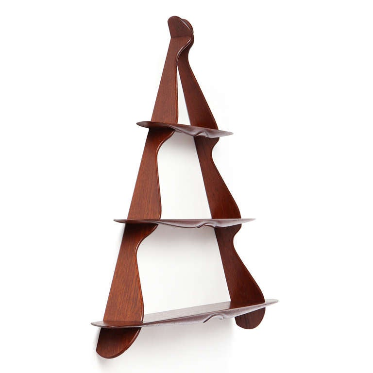 A well-crafted triangular shaped three-tiered wall-mounted shelf.