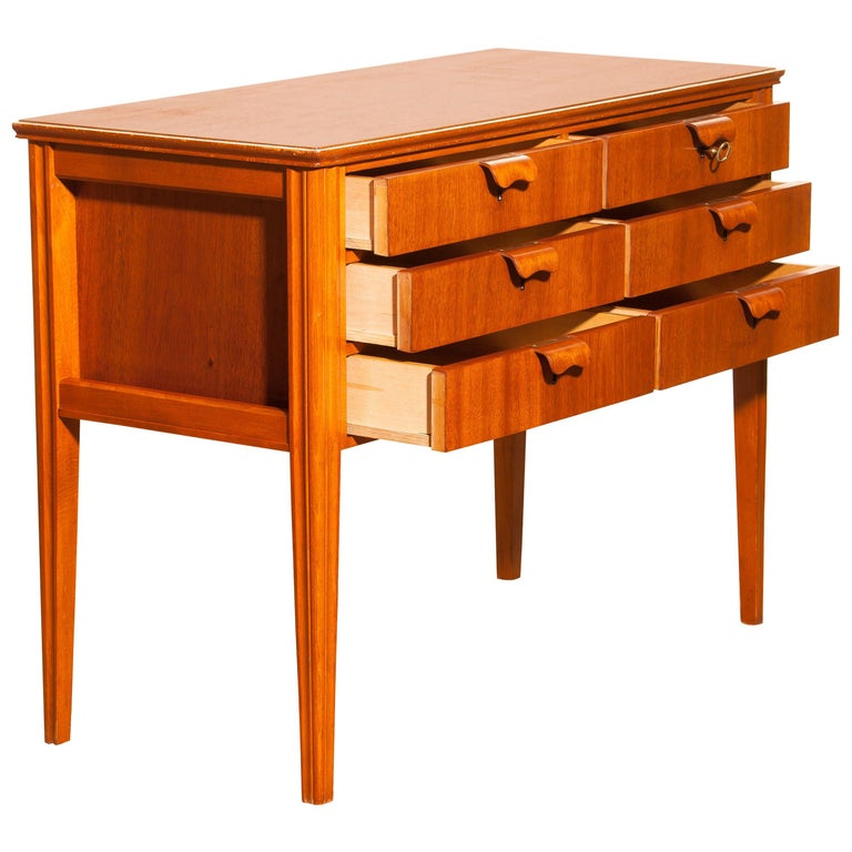 Beautiful chest of drawers made by Ferdinand Lundquist, Sweden. This cabinet is made of teak and beech and has six drawers. It is in excellent condition. Period, 1950s. Dimensions: H 72 cm, W 96 cm, D 43 cm.