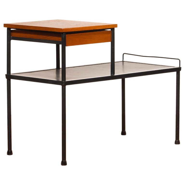 Very nice side table, bench or telephone table. This table is made of black lacquered metal and has a teak writing space with a drawer. It is in a lovely original condition. Period, 1950s. Dimensions: H 62 cm, W 78 cm, D 40 cm.