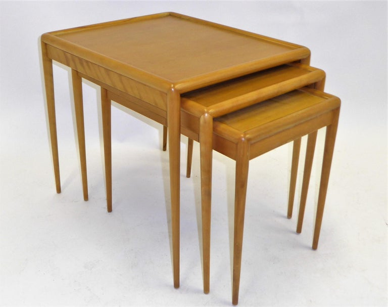 Mid Century Modern super set of three matching nesting / stacking tables by T.H. Robsjohn-Gibbings for Widdicomb model no. 1783. In very good condition. Slight wear, see pics. Beautiful blond figured walnut in sorrel finish, retains signature decal.