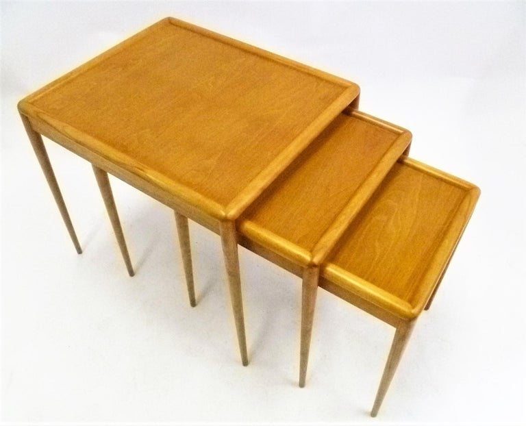 Super set of three matching Mid Century Modern nesting / stacking tables by T.H. Robsjohn-Gibbings for Widdicomb model no. 1783. In very, very good condition. Beautiful blond figured walnut in sorrel finish, retains signature decal. Original