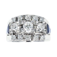 1950s Thirteen Round Diamond Bridal Ring Accented with Two Sapphire Trapezoids