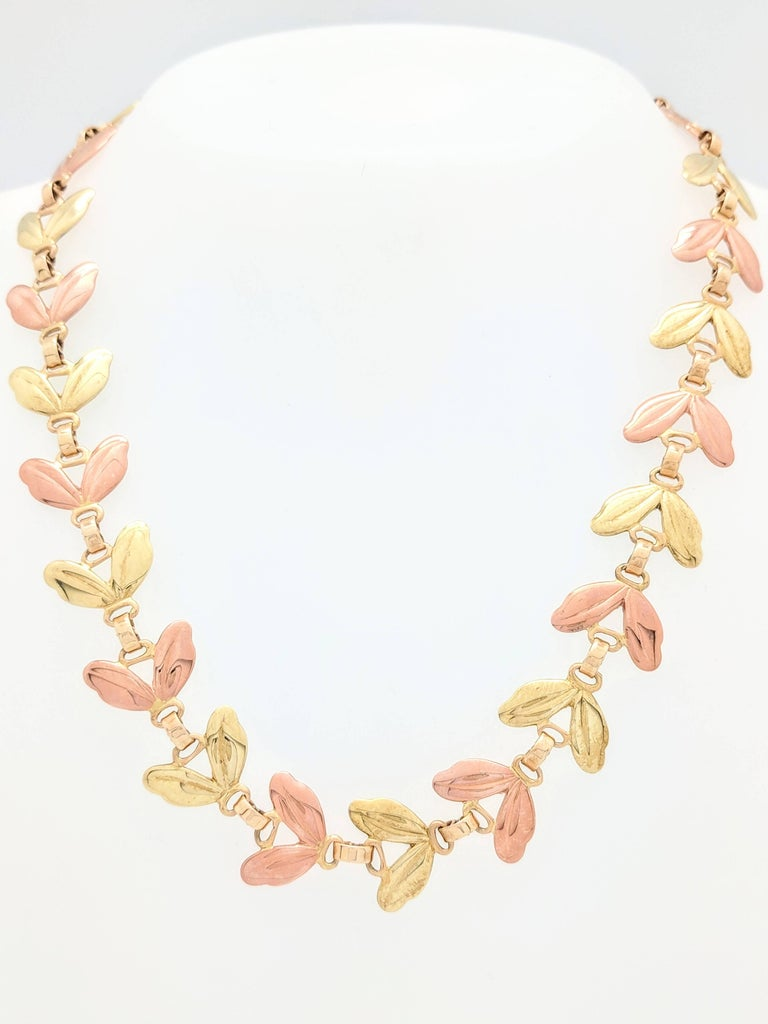 You are viewing an Authentic RARE Vintage Tiffany & Co. 14 karat Two Tone Gold Leaf Link Necklace. This necklace is from the early 1950's and is crafted from 14 karat pink and yellow gold. The yellow gold portion of the necklace has a slightly