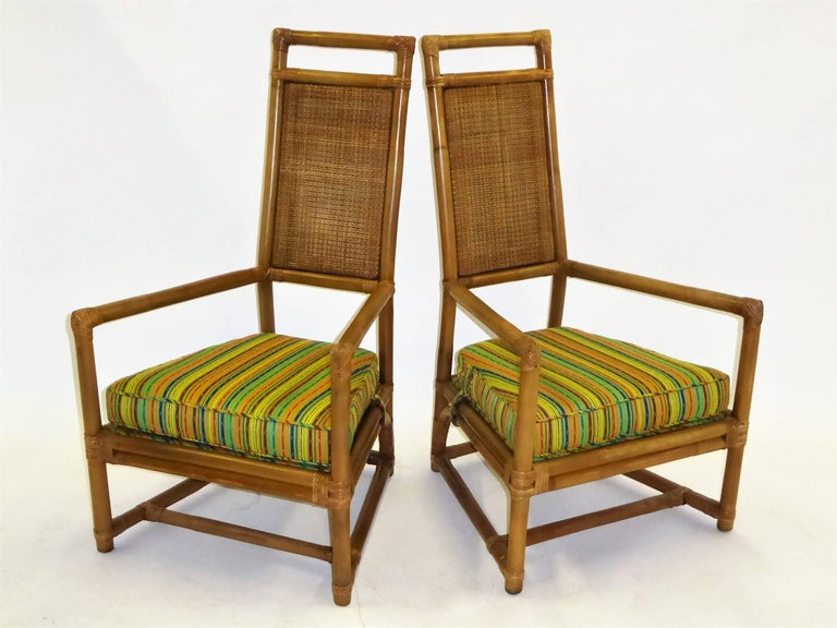 From the Pavilion collection for Willow and Reed, Inc., a pair of  Henry Olko armchairs. A 1950s design in rattan and cane with throne chair regal aspirations with high backs and wide arms. Outstanding creation with Willow and Reed superb quality