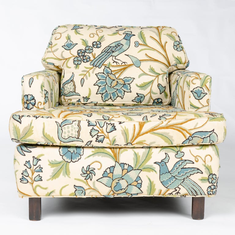 An upholstered lounge chair in vintage flora and fauna print having two swivel casters, designed in 1958 as an addition to the Conversations Group introduced in 1955.