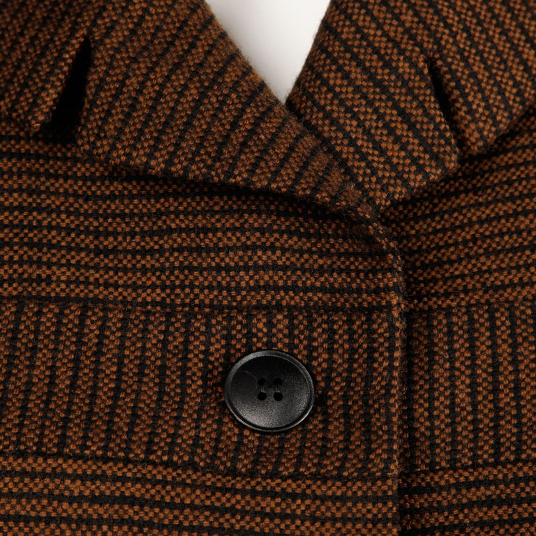 Darling vintage 1950s brown and black striped wool blazer jacket. Fully lined with front button closure. Small shoulder pads are sewn in underneath the lining. Fits like a modern size small. The bust measures 40