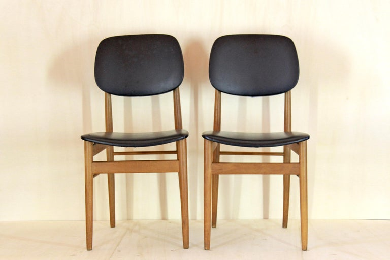 Two dining chairs designed by