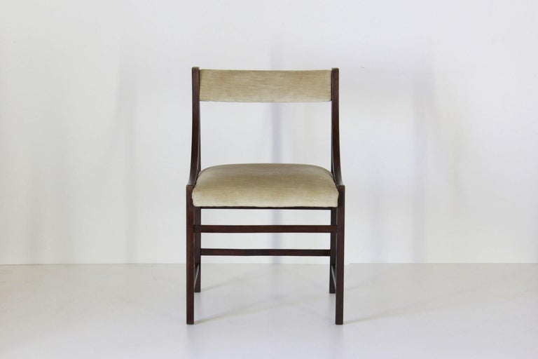 A set of four 1950s vintage dining chairs with velvet cover. All parts are still the original ones. In good conditions with only few signs of time.