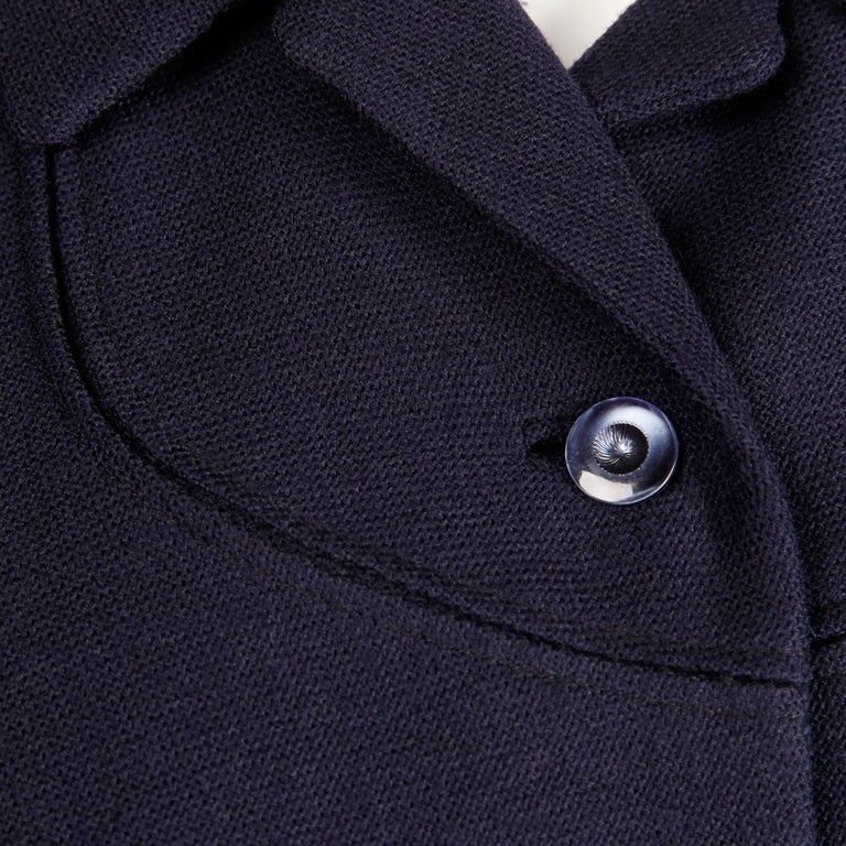Darling early-1950s vintage blazer jacket in navy blue wool. Fully lined with front button closure. Small shoulder pads are sewn in underneath the lining. Fits a modern size XS. The bust measures 35