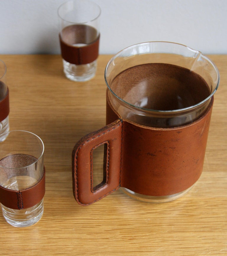 Mid-Century Modern 1950s Vintage Tan Leather Jug and 6 Hand Blown Glasses by Carl Auböck For Sale