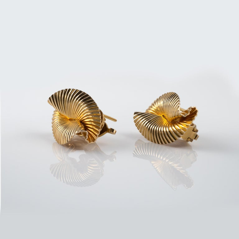 Pair Of Classic 1950S Tiffany & Co Double Fan Earrings 14 Karat Yellow Gold  These fabulous clip earrings are crafted with a fluted (ribbed) texture that is folded into a dynamic fan shape. The backs are stamped with' TIFFANY & CO' and 'PAT 2423905.