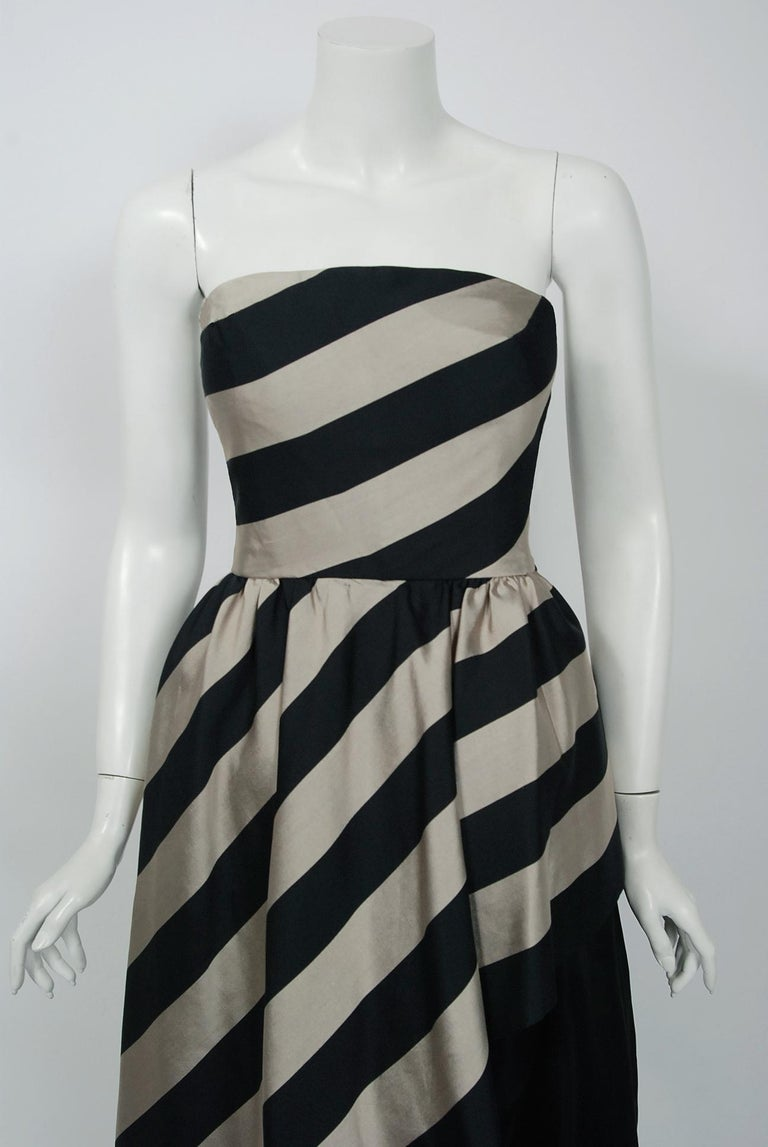 An amazing and highly stylized 1950's striped silk evening gown ensemble by Werle of Beverly Hills. Daniel Werle designed clothing for many Hollywood stars including Barbara Stanwyck, Marlo Thomas, Gloria Swanson and, most notably, many of the