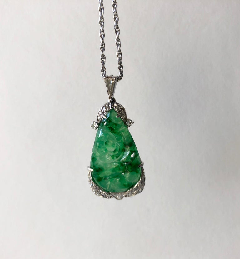 1950's demi parure consisting of carved jade and diamonds set in 14K white gold.  Pendant measures 1.5
