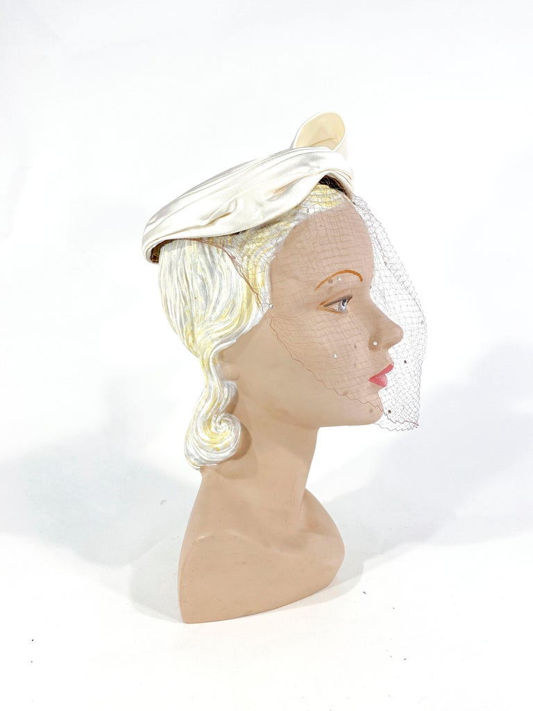 Gray 1950s White Satin Cocktail Hat with Sculpted Bow For Sale