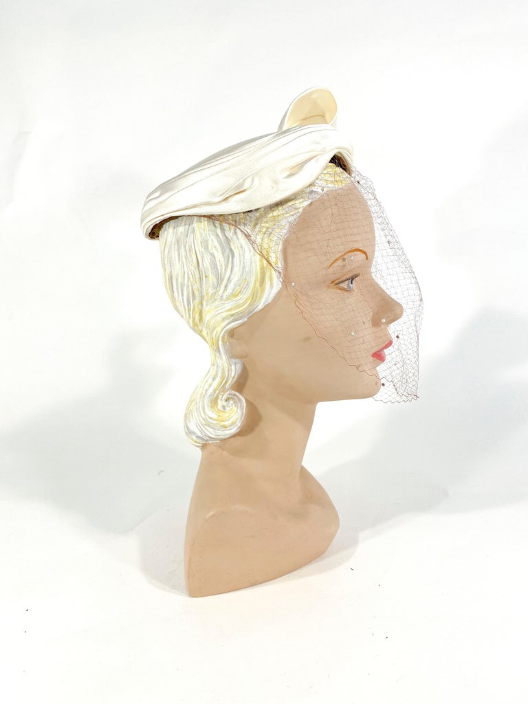 Women's 1950s White Satin Cocktail Hat with Sculpted Bow For Sale