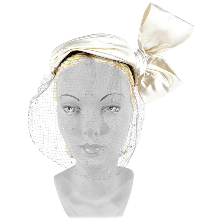 1950s White Satin Cocktail Hat with Sculpted Bow For Sale