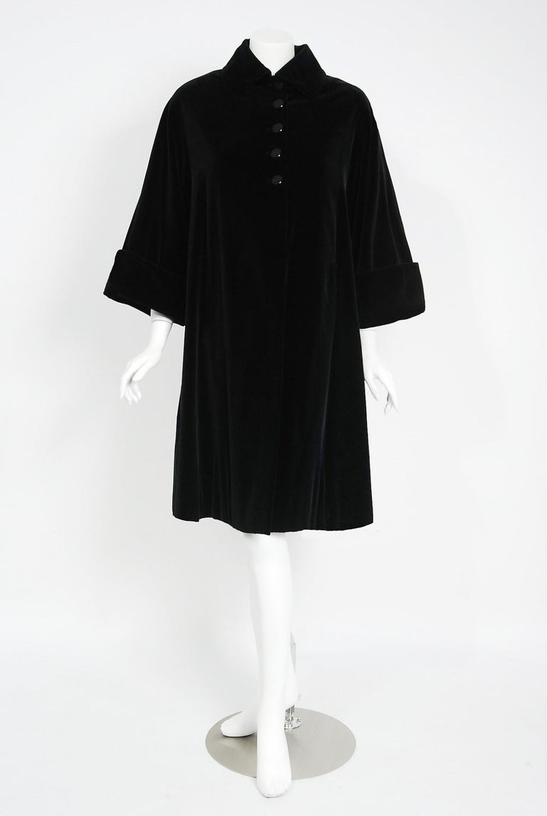 Breathtaking Pierre Balmain Paris black velvet swing coat dating back to his 1951 Fall/Winter collection. Pierre Balmain worked under Robert Pigiuet, Molyneux, and Lucian Lelong, where he worked closely with Christian Dior. In 1945 is finally opened