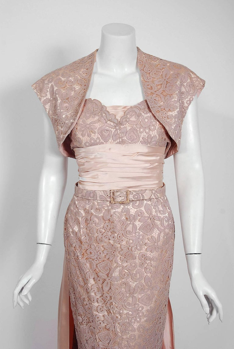Breathtaking Pierre Balmain pale champagne pink silk and lace demi-couture gown ensemble dating back to his 1952 collection. Balmain created a very sculptural quality which was always allied with a ladylike essence. His garments have a body and a