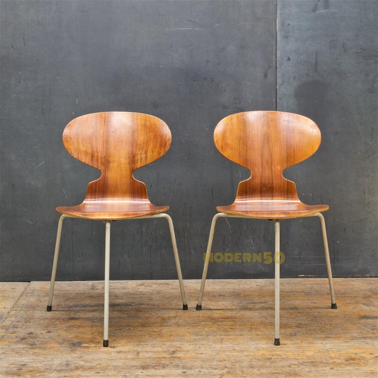Pair of rare 1st year of production FH3100 Myren Ant Chairs. Edge wear to both chairs all chips have been filled/restored, one chair has two replaced feet/glides, and one chair has two chips to the plastic sheathing over the steel legs.  The Ant