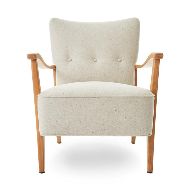 Lovely c1953 Folke Ohlsson for AP Madsen' 'Modern' armchair. Originally manufactured in Vancouver, Canada. Newly refinished beech wood frame, and reupholstered in Pollack's Lana E Seta wool in 'Cocoon'. This chair is in perfect condition and ready