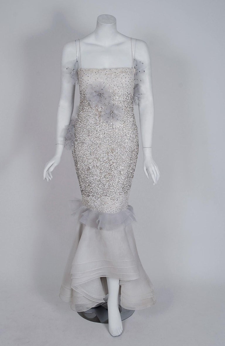 Gorgeous Nina Ricci custom gown dating back to their 1955 couture collection. The French fashion house Nina Ricci, known for its feminine, ladylike clothing, has long been the go-to for Parisian chic. Elegant Frenchwomen and their daughters streamed