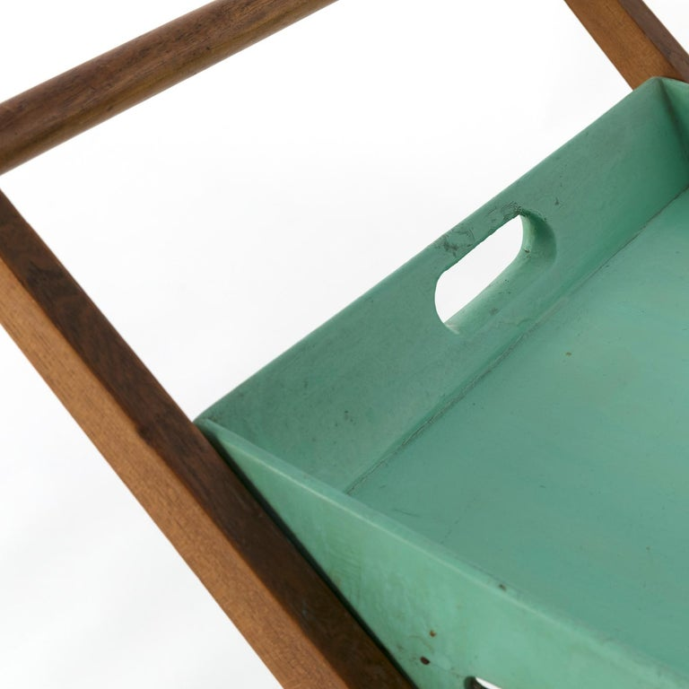 1955 foldable serving cart designed by Angelo Ostuni and manufactured by Frangi, Milan. Elm tree wood, brass details and original green painted tray. Copy of the historical publication will be provided.