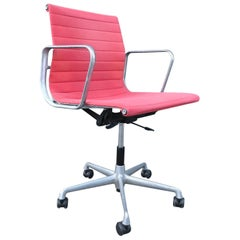 1958, Ray and Charles Eames Red Adjustable Tilt Office Chair with Five Wheels