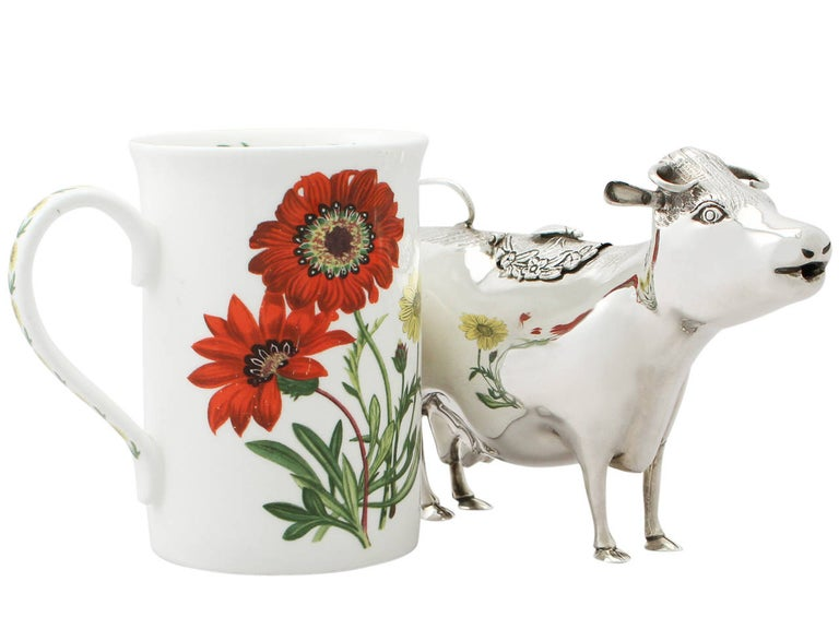 A fine and impressive vintage Elizabeth II English sterling silver cow creamer made in 18th century style; an addition to our silver teaware collection.  This vintage Elizabeth II sterling silver cow creamer has been modelled in the style of an