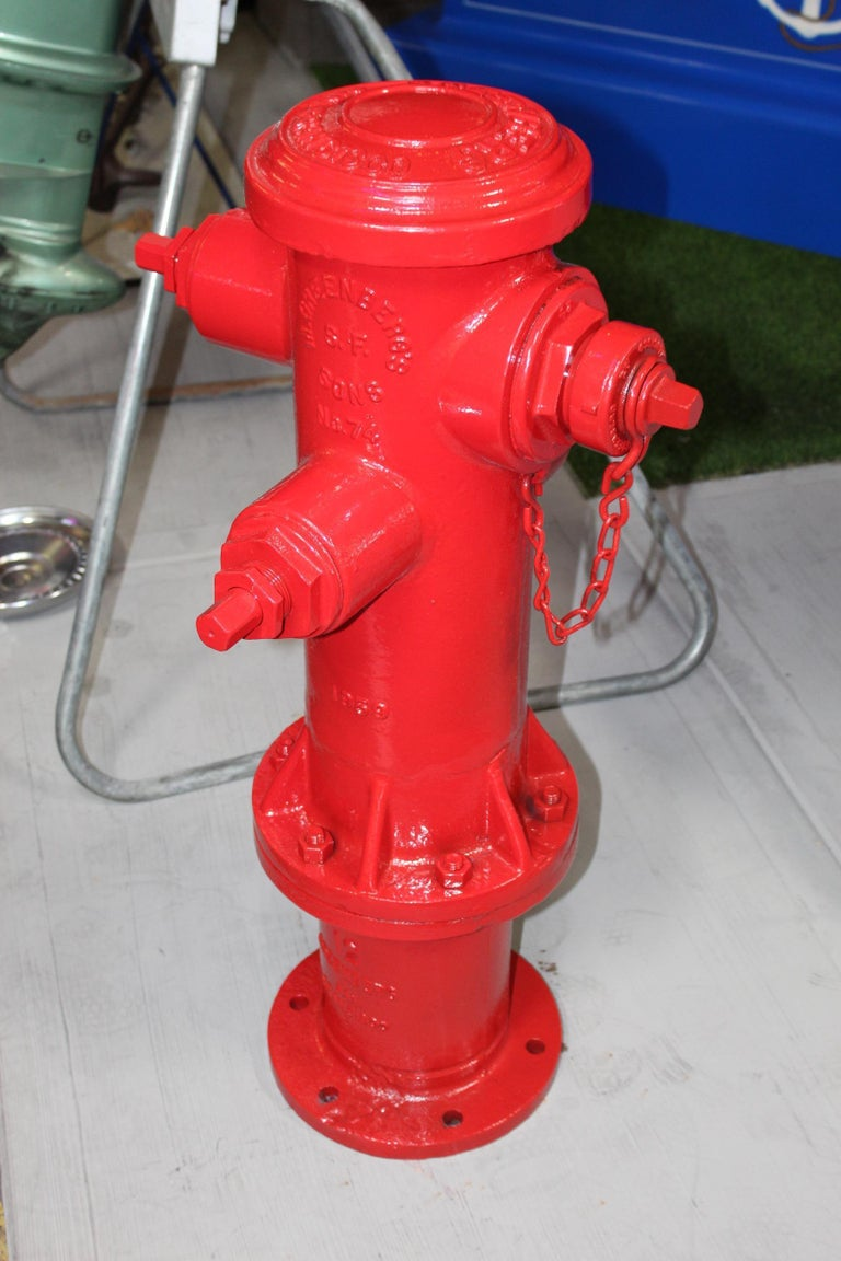 Heavy cast iron fire Hydrant that has been repainted in fire engine red. This is model 74 manufactured in San Francisco.