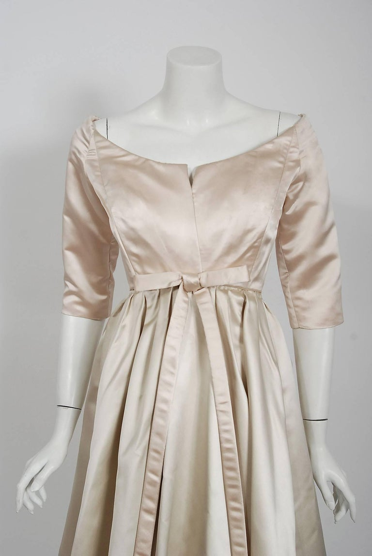 We are pleased to offer this important and incredibly rare documented party dress from the Christian Dior Couture collection of 1959 when Yves Saint Laurent was head designer. Yves Saint Laurent continued the Dior tradition of elegant construction