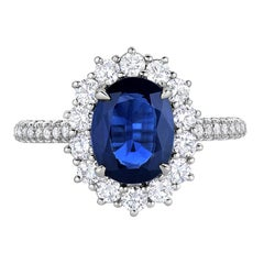1.96 Carat Blue Oval Sapphire and Diamond Cocktail Halo Ring