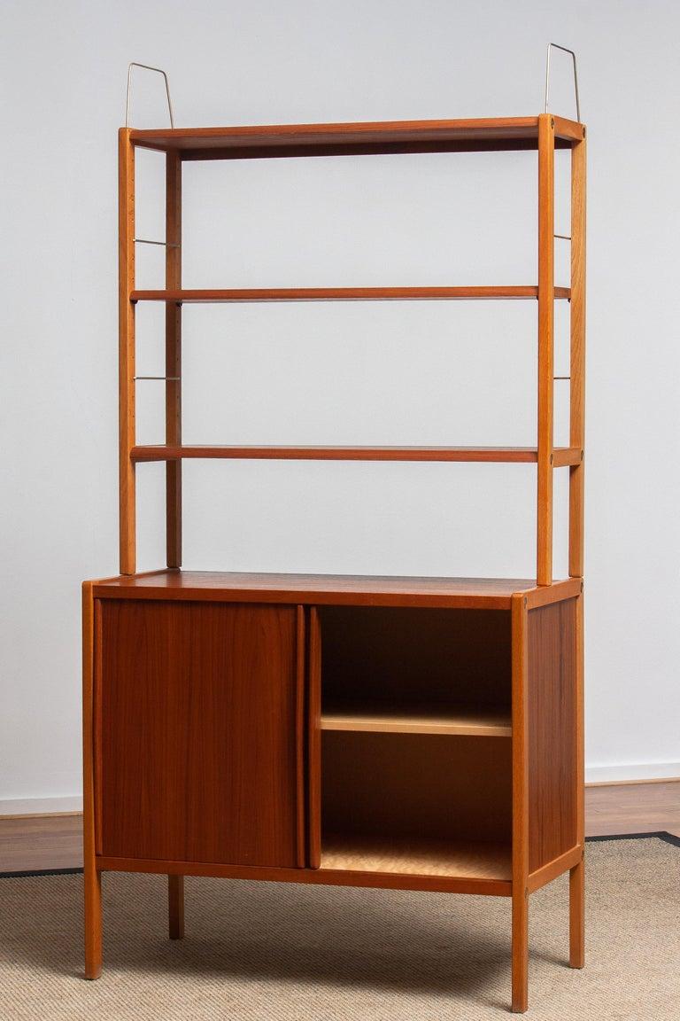 1960, 1 Teak / Oak and Brass Bookcase by Bertil Fridhagen for Bodafors, Sweden For Sale 3