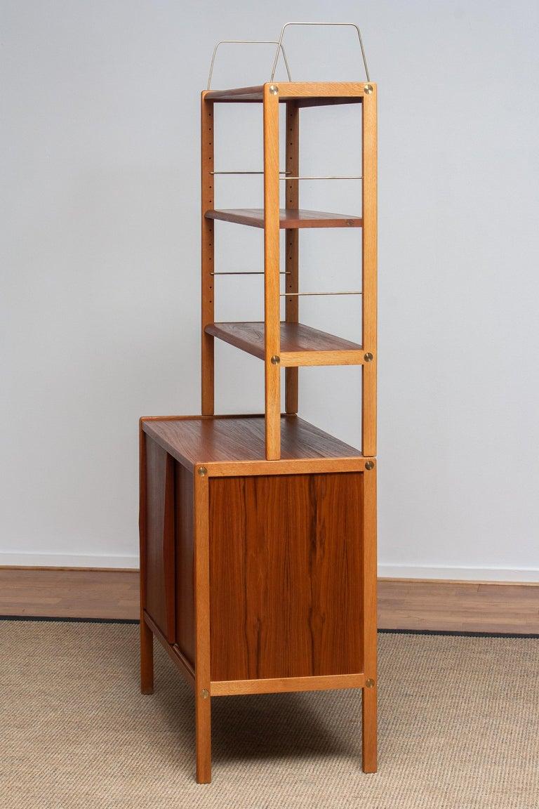 Veneer 1960, 1 Teak / Oak and Brass Bookcase by Bertil Fridhagen for Bodafors, Sweden For Sale