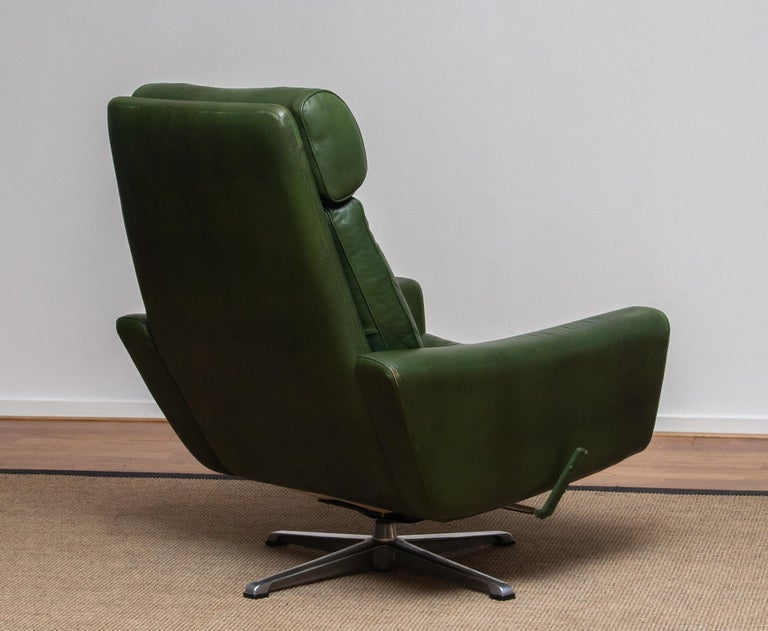 1960 Bottle Green Leather Swivel and Rocking Lounge Chair and Ottoman by Ulferts 6
