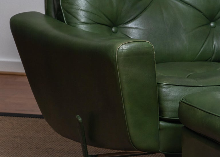 Swedish 1960 Bottle Green Leather Swivel and Rocking Lounge Chair and Ottoman by Ulferts