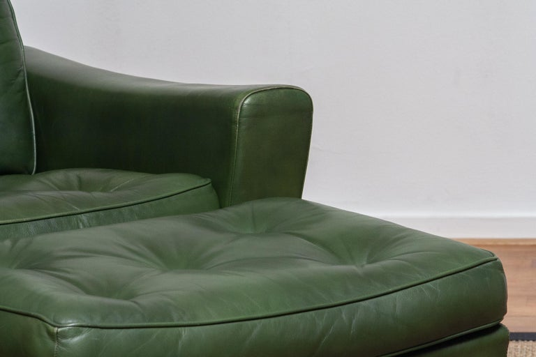 Mid-20th Century 1960 Bottle Green Leather Swivel and Rocking Lounge Chair and Ottoman by Ulferts