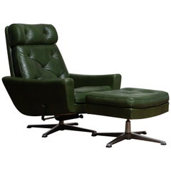 1960 Bottle Green Leather Swivel and Rocking Lounge Chair and Ottoman by Ulferts
