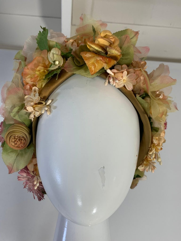 1960s Christian Dior silk spring floral turban hat by Marc Bohan for Dior. Beautiful muted florals and greenery are so delightful!  Mesh base fabric with satin edging. Size 22. Medium