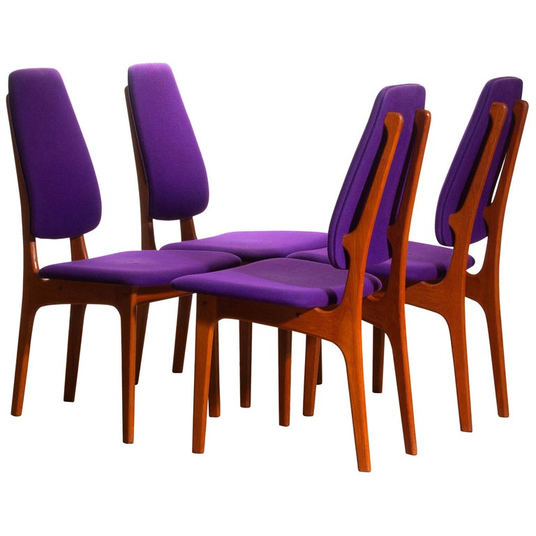 Rare set of four dining chairs from the 1960s in teak designed by Erik Buch for O.D. Möbler A.S., Denmark. Beautiful aspect are the slim and high back rests. Chairs are marked
