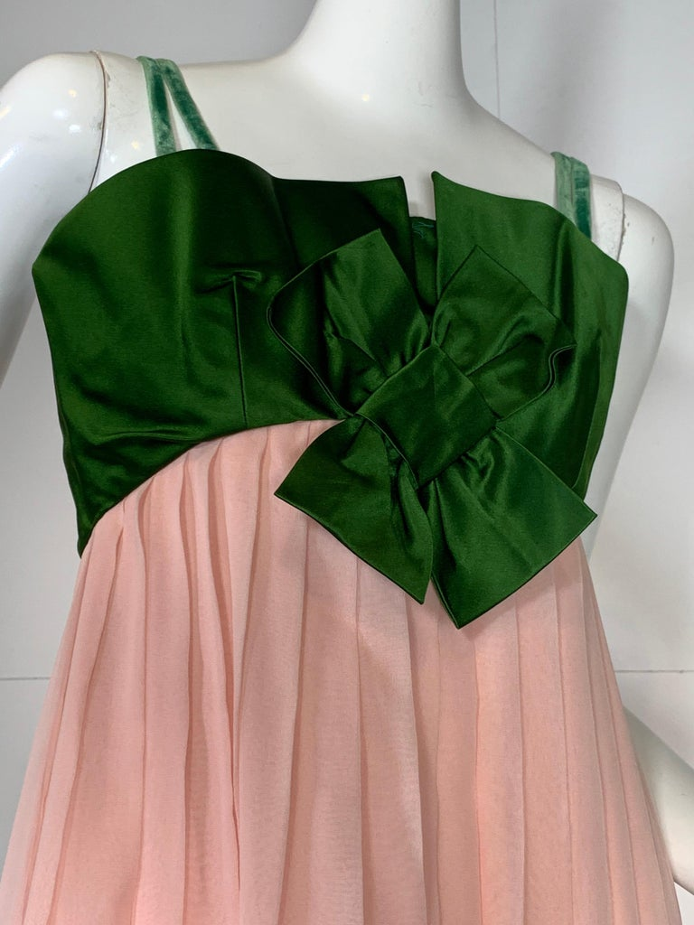1960s Harold Levine Empire-waist olive green silk satin bodice gown with peach silk chiffon flowing skirt. Inner corset structure in bodice. Velvet ribbon straps added but could possibly be worn strapless. Back zipper.