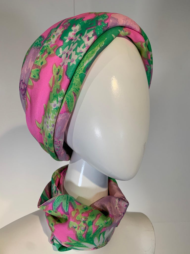 1960 Irene of New York fluorescent floral print turban hat and matching foulard / neck scarf ensemble: In shades of pink, lavender and green. Size Medium. Originally sold at I. Magnin.