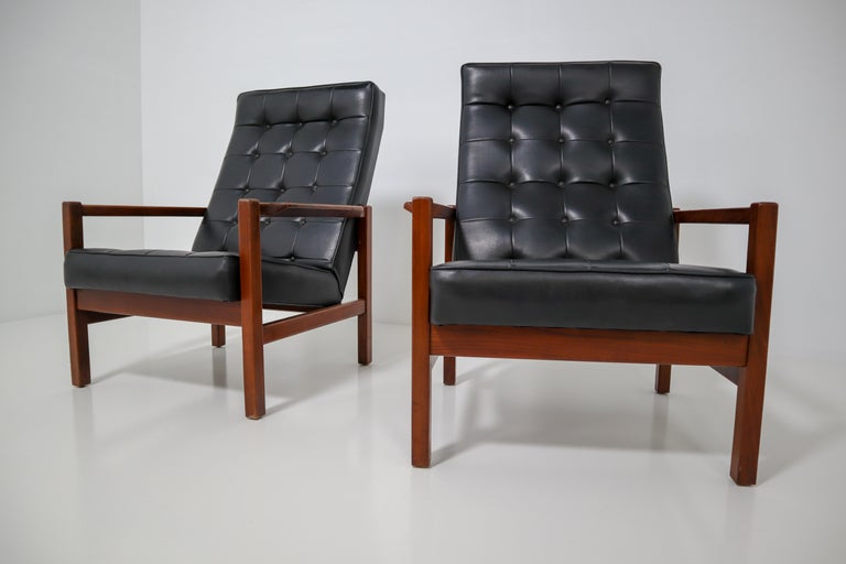 These armchairs contains solid rosewood frame and black leather upholstery. Upholstered with original leather in great vintage condition. Manufactured in the 1960s in England.