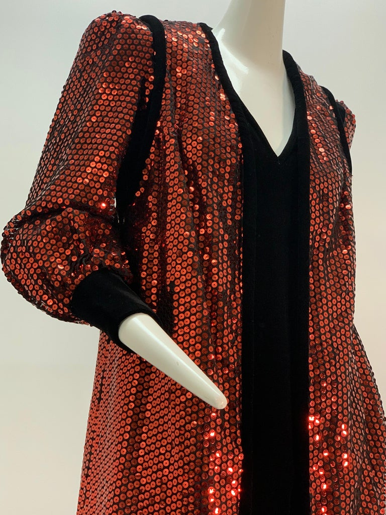 A fabulous 1960s Mr. Blackwell Custom crimson red sequin and black velvet gown and maxi vest ensemble: a gown of velvet with V-neck, puffed shoulders and blouson sleeves of sequins and banded velvet cuffs is paired with a maxi vest of sequins and