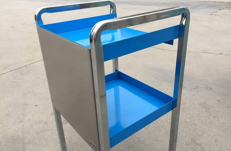 Retro steel medical cart refinished in high gloss powder coated blue and stainless steel. Put this unique piece to use as a bar cart, bathroom storage solution or nightstand, it's versatile and quality-made. Excellent refinished