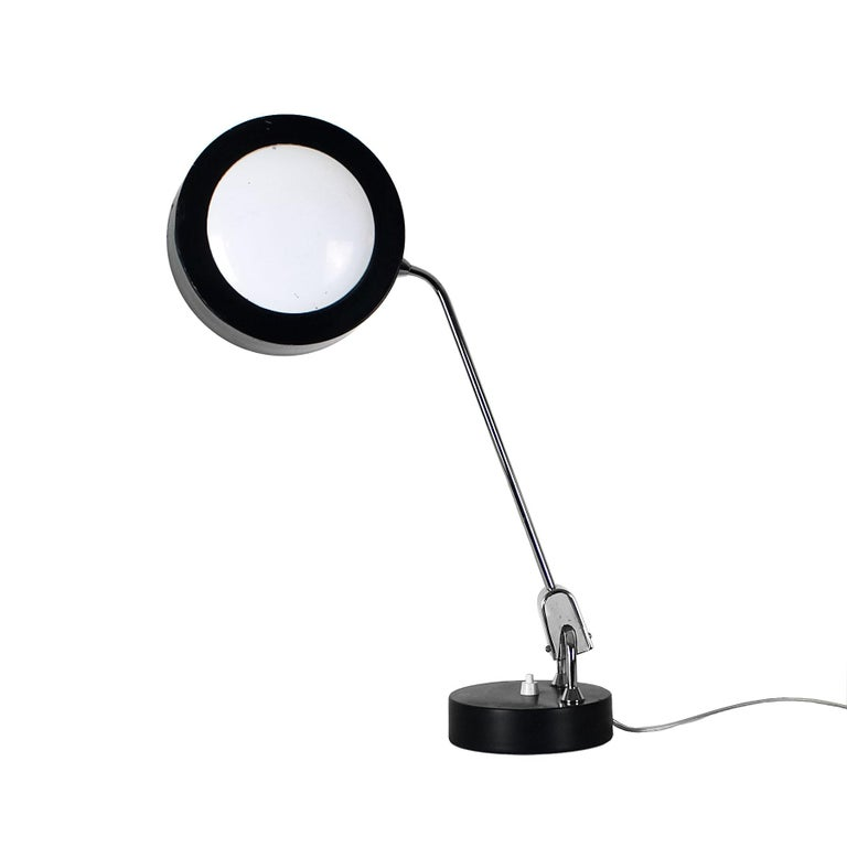 Desk lamp, articulated by ball joints, black and white lacquered steel base and lampshade, nickel-plated brass stand and joint, original switch. Design: André Mounique Maker: Maison Jumo  France, circa 1960.