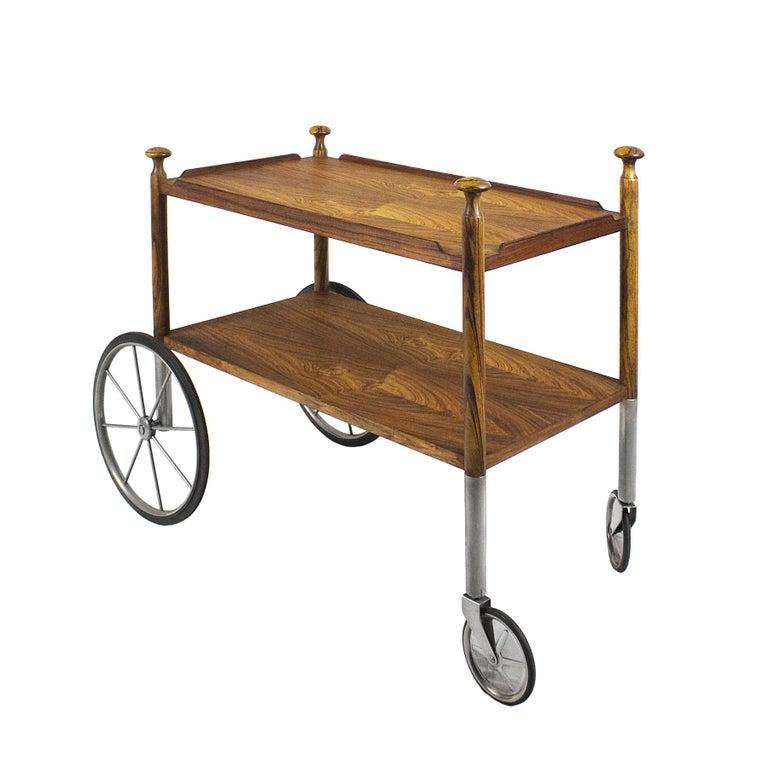 Bar cart, solid zebra wood with zebra wood veneer, chrome-plated metal castors and base feet.  Design: Walter Wirz Maker: Wilhelm Renz  Germany circa 1960.