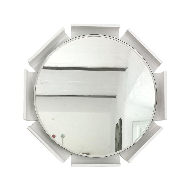 Large beveled mirror with a white lacquered wood frame, backlighting system.  Italy, circa 1960.